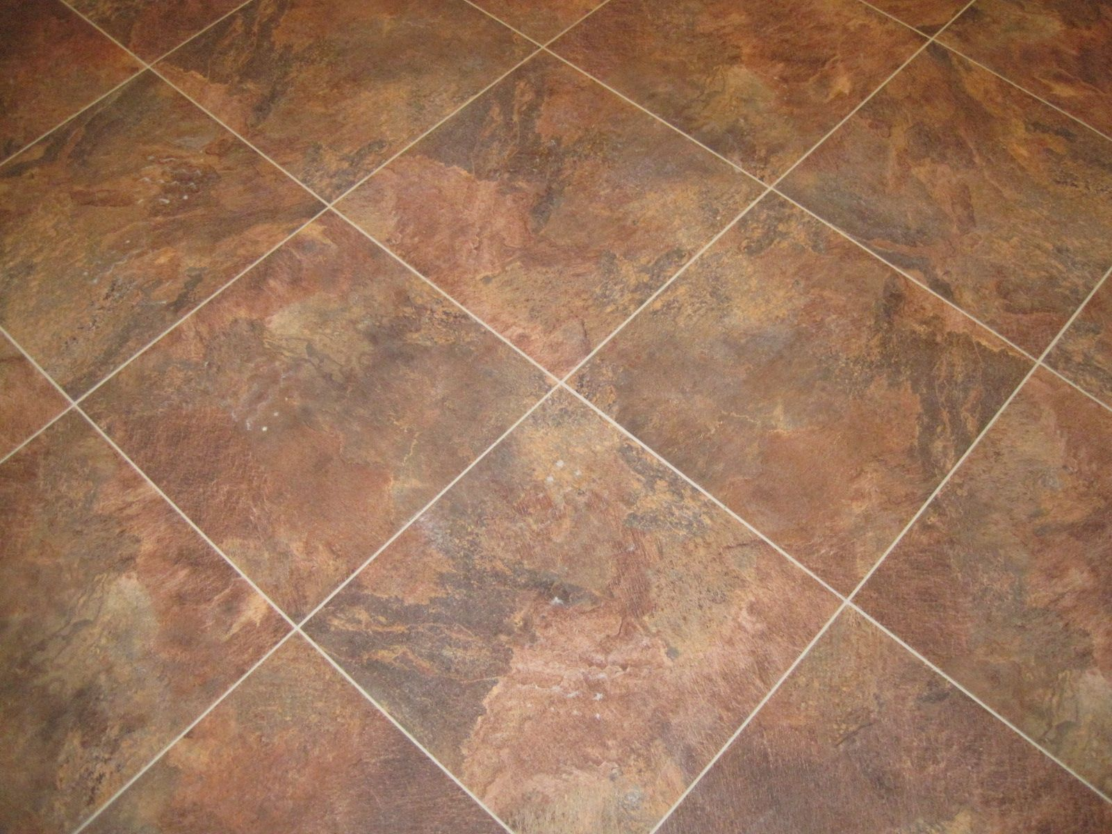 The Kitchen Flooring A Large Vinyl Tile With Stone Powder Embedded