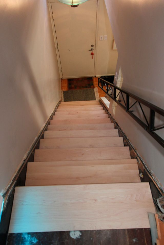 A view down the stairway with the straight treads in place, prior to being shaped.