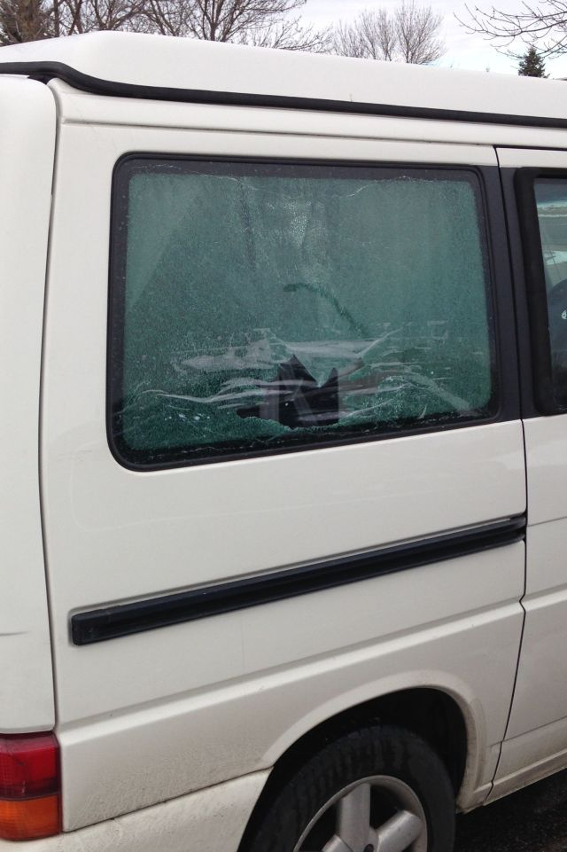 The rear passenger side window, shattered by a tipping bandsaw!