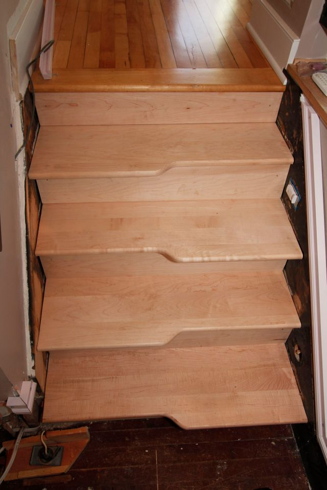 The top four steps from the landing to the second floor were the training ground where I learned the methods for making and installing custom treads and risers.