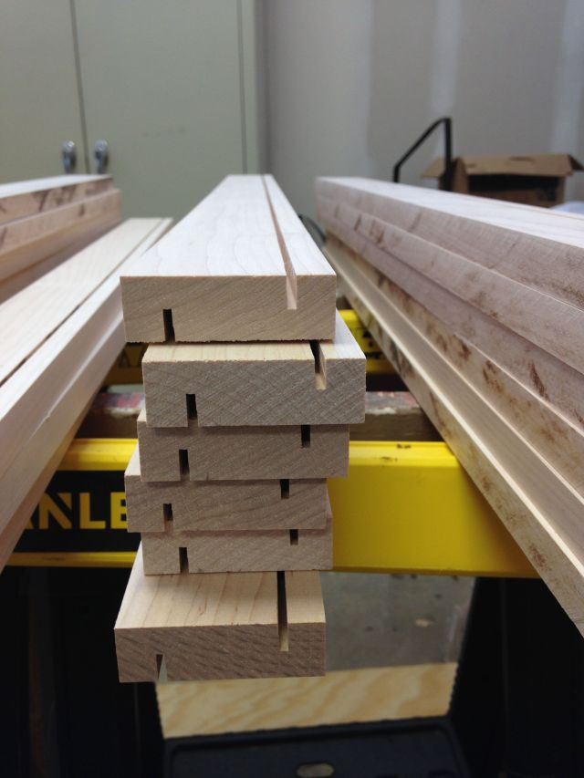 Wood strips cut to width and with first cuts for the overlapping scheme to substitute for tongue and groove.
