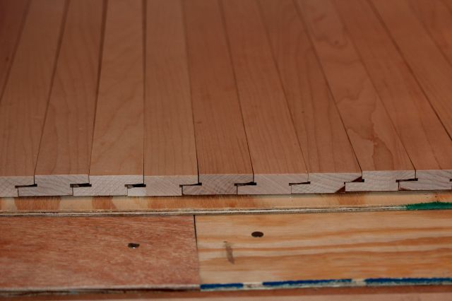 The floor boards, fitted and screwed into place.  Almost as good as the real thing!